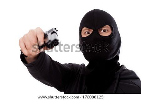 Burglar with gun and mask on white isolated background - stock photo
