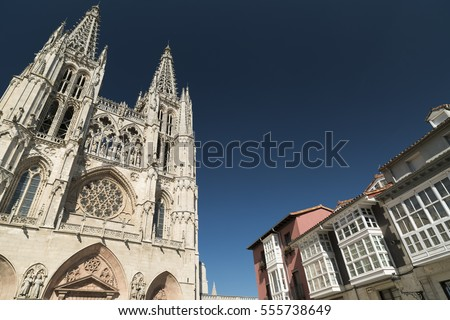 Burgos (Castilla y Leon, Spain): exterior of the medieval cathedral, in gothic style and houses with the typical verandas