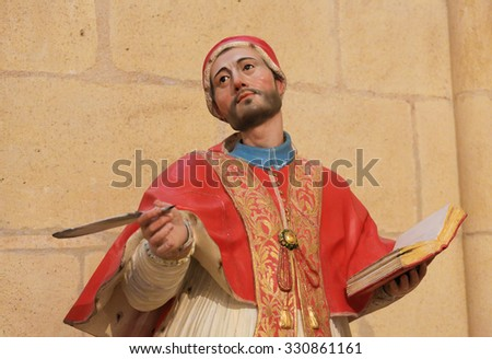 BURGOS, SPAIN - AUGUST 13, 2014: Polycrhome Statue of a Theologian in the Cathedral of Burgos, Castille, Spain - stock photo