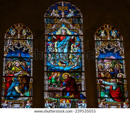 BURGOS, SPAIN - AUGUST 13, 2014: Stained glass window depicting the Assumption of Mary in the cathedral of Burgos, Castille, Spain.