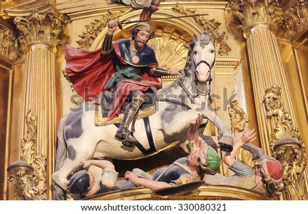 BURGOS, SPAIN - AUGUST 13, 2014: Statue of Saint James the Moor-slayer or Santiago Matamoros in the Cathedral of Burgos, Castille, Spain - stock photo