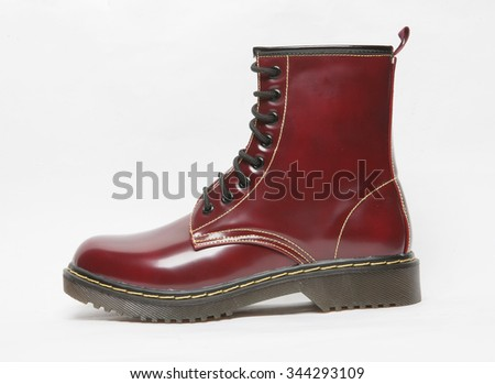 burgundy punk rock style boot isolated - stock photo