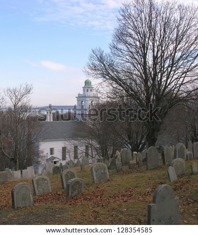 Burial Hill Plymouth, Massachusetts over looking white church.