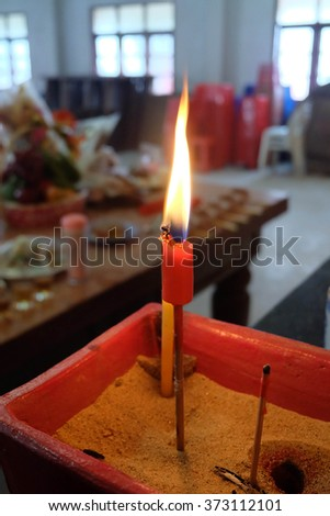 Buring incenses to worship the ancestors for Chinese New Year - stock photo