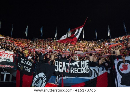 BURIRAM, THA- APRIL 27: Fans of Muangthong United in action during the competition Thai League 2016 between Buriram Utd. and Muangthong Utd. at I-Moblie Stadium on April 27, 2016 in Buriram, Thailand. - stock photo