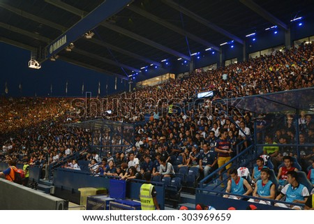 Buriram, Thailand - AUG 1: Fans cheering in stadium during the competition Thai Premier League 2015 between Buriram Utd. and Muangthong Utd. at I-Moblie Stadium on August 1, 2015 in Buriram, Thailand. - stock photo