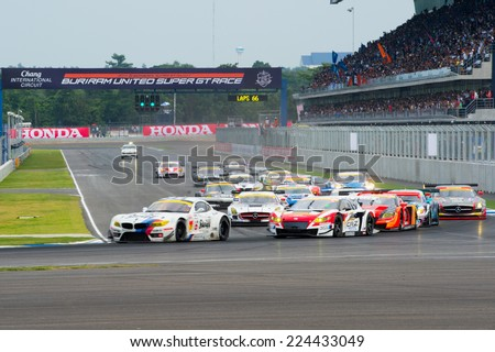 BURIRAM THAILAND-OCTOBER 5:Jorg Muller (L) of BMW Sports Trophy Team Studie locks up at the start of the Autobacs Super GT Round7 at Chang International Circuit,on Oct 05,2014 in,Thailand - stock photo