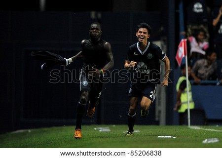 BURIRAM, THAILAND-SEPT 21:Frank Opoku Acheampong(L) of Buriram PEA in action during Toyota League Cup between Buriram PEA(B) and Chonburi Fc(G) at I-mobile Stadium on September 21, 2011 in Buriram Thailand - stock photo