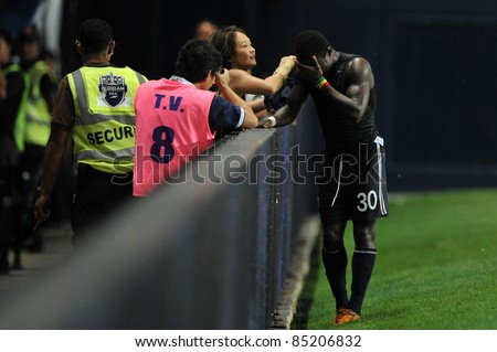 BURIRAM, THAILAND-SEPT 21:Frank Opoku Acheampong of Buriram PEA in action during Toyota League Cup between Buriram PEA(B) and Chonburi Fc(G) at I-mobile Stadium on September 21, 2011 Buriram, Thailand - stock photo