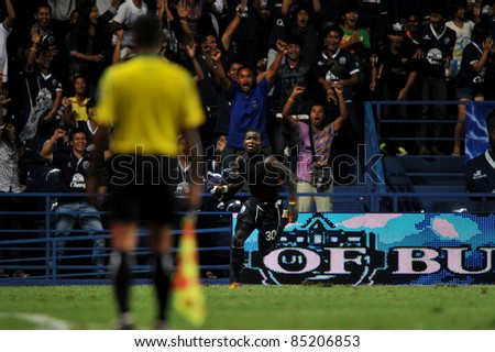 BURIRAM, THAILAND-SEPT 21: Frank Opoku Acheampong of Buriram PEA in action during Toyota League Cup between Buriram PEA(B) and Chonburi Fc(G) at I-mobile Stadium on September 21, 2011 in Buriram, Thailand - stock photo