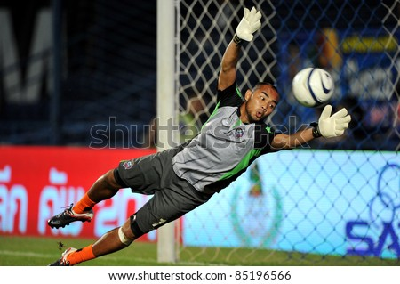 BURIRAM, THAILAND-SEPT 21: Siwarak Tedsungnoen(GK) of Buriram PEA in action during Toyota League Cup between Buriram PEA(B) and Chonburi Fc(G) at I-mobile Stadium on September 21, 2011 in Buriram, Thailand. - stock photo