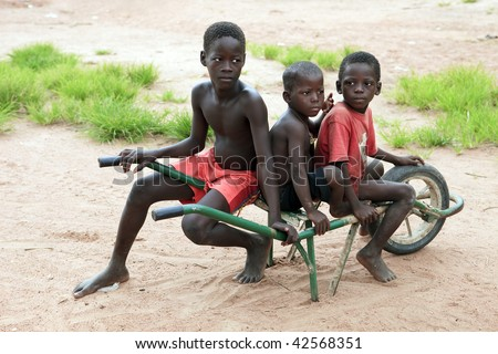 BURKINA FASO - AUGUST 12: Children of the Lobi ethnic group, children are responsible for monitoring the field and animals, August 12, 2009 in Gaoua, Burkina Faso - stock photo