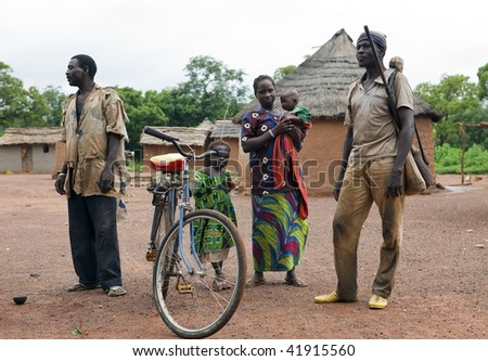 BURKINA FASO - AUGUST 13: Family of ethnic Senoufo, the Senoufo community living in villages where what matters is the common good, August 13, 2009 in Country Senoufo, Burkina Faso - stock photo