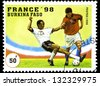 "BURKINA FASO - CIRCA 1996: A stamp printed in Burkina Faso, shows football players with inscription ""France, 1998"", from series ""1998 World Cup Soccer Championships, France"", circa 1996. - stock photo"