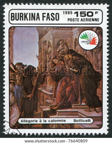 """BURKINA FASO - CIRCA 1985: A stamp printed in the Burkina Faso, is dedicated to International Philatelic Exhibition, Italy-85, shows a picture of Botticelli, """"Calumny of Apelles"""", circa 1985 - stock photo"""
