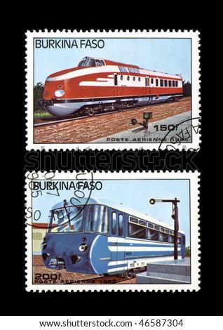 BURKINA FASO - CIRCA 1985: Obsolete canceled postage commemorative honoring railroad locomotives, circa 1985, Burkina Faso - stock photo