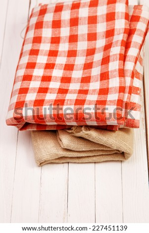 Burlap and cloth in the box on a white table