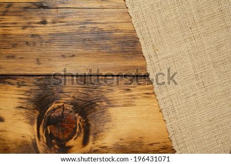 Burlap and wood background - stock photo