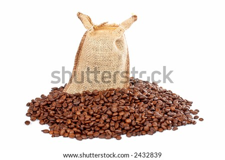 Burlap sack with coffee beans spilling out over a white background - stock photo