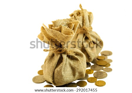 burlap sack with coins isolated on white background
