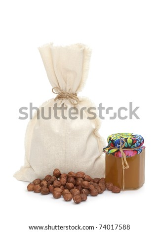Burlap sack with hazelnuts and honey isolated on white