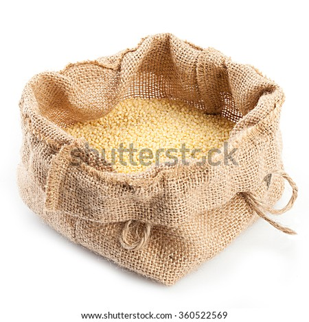 Burlap sack with millet isolated on white background.