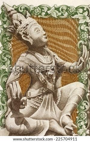 BURMA - CIRCA 1985: Dancer on 75 Kyats 1985 Banknote from Burma. - stock photo