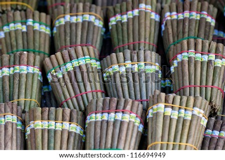 Burmese home-rolled cigar at local market, Myanmar - stock photo