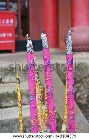 burn incense for prayer happiness in temple in religion of taoism or buddhism - stock photo