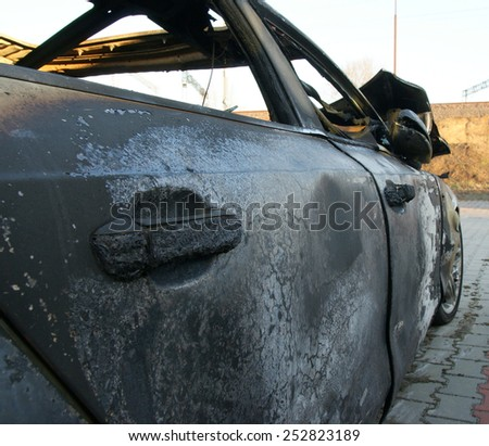 Burn sports car wreck - right side - stock photo