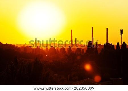 Burn sunset view of the city. Yellow bright sun light, beautiful panorama sunburst. - stock photo