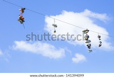 BURNABY, BRITISH COLUMBIA,CANADA-MAY 5. An urban trend of tossing shoes on power lines on May 5, 2013 in Burnaby Canada. Shoe tossing is a mystery that happens all over urban areas.