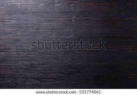 Burned black wooden texture background copy space