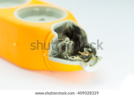 burned by voltage, yellow electric extension cord on a white background close-up