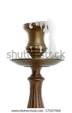 burned candle in an antique candlestick isolated on white background - stock photo