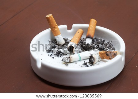 burned cigarettes is in ashtray - stock photo