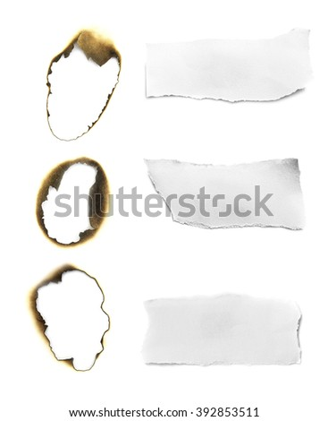 burned hole in paper and ripped in paper on white background - stock photo