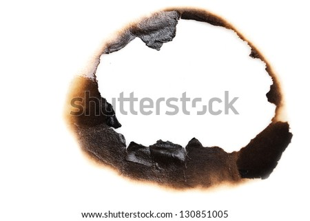 burned hole on a white paper background - stock photo