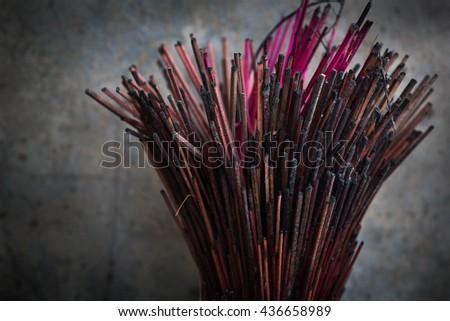 burned Incense sticks in joss-stick pot design in vignette - stock photo