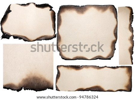 Burned old blank paper, isolated on white background - stock photo
