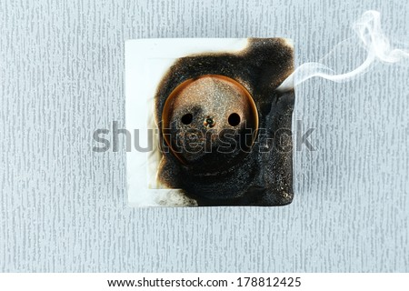 Burned plug socket close up - stock photo