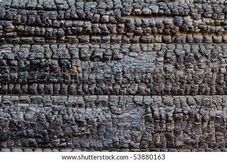 burned timber wall - stock photo