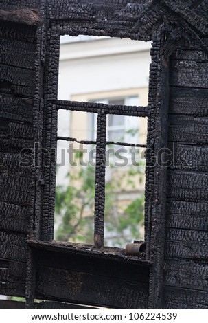 Burned wooden window frame. - stock photo