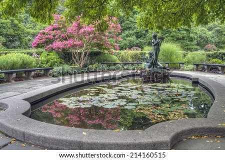 Burnett Fountain  The Secret Garden. The bowl is a functioning birdbath where small birds drink during three seasons of the year.  - stock photo