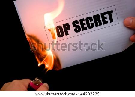 burning a top secret paper document - stock photo