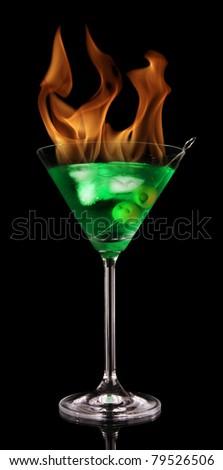 Burning alcoholic drink, isolated on black background - stock photo
