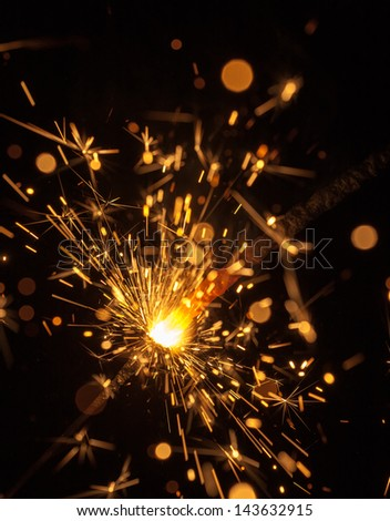 Burning Bengal fire on a black background - stock photo