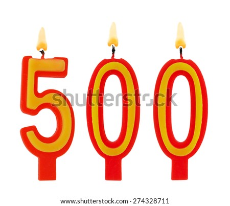 Burning birthday candles isolated on white background, number 500 - stock photo