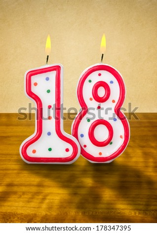 Burning birthday candles number 18 - stock photo