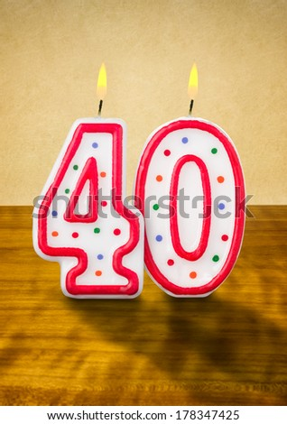 Burning birthday candles number 40 - stock photo
